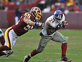 Landover, MD - November 30, 2008 -- New York Giants running back Derrick Ward (34) eludes Washington Redskins defensive end Jason Taylor (55) late in the second quarter at FedEx Field in Landover, Maryland on Sunday, November 30, 2008..Credit: Ron Sachs / CNP.(RESTRICTION: No New York Metro or other Newspapers within a 75 mile radius of New York City)