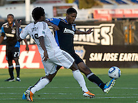 Khari Stephenson of Earthquakes controls the ball away from Clyde Simms of DC United during the game at Buck Shaw Stadium in Santa Clara, California on July 30th, 2011.   DC United defeated San Jose Earthquakes, 2-0.