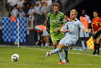 Michael Harrington (2) defender Sporting KC passes the ball..... Sporting Kansas City were defeated 1-2 by Seattle Sounders at LIVESTRONG Sporting Park, Kansas City, Kansas.