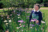 A renowned expert on Louisiana Iris, Marie Caillet  pauses for a moment in her iris filled garden in Denton, Texas