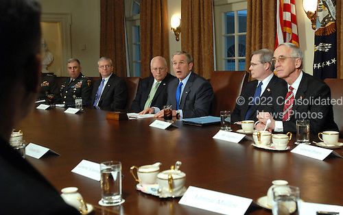 Washington, D.C. - January 24, 2007 -- United States President George W. Bush makes a statement to the press during a meeting with military leaders in the Cabinet Room of the White House on January 24, 2007. From left are Commander of U.S. Central Command (CENTCOM) Army General John Abizaid, White House Chief of Staff Joshua B. Bolten, Vice President Dick Cheney, Bush, National Security Advisor Stephen Hadley and Deputy Secretary of Defense Gordon England. .Credit: Roger L. Wollenberg - Pool via CNP