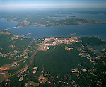 Aerial View: Looking north east at the York River and Chesapeake Bay in background. Yorktown Virginia on the left with the Coleman Bridge (Rt 17) to Gloucester. Western/Giant Oil Refinery is a center on the river and a coal fired power plant.  Yorktown, Newport News to Gloucester County area from about 7500 feet 09/26/2001