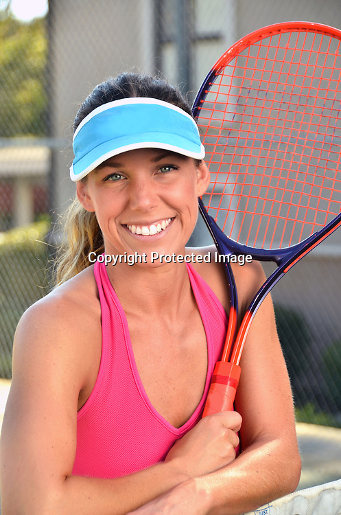 Stock photo of Woman ay Tennis Court