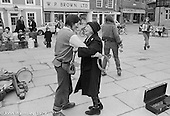 """Ros Davies dancing with """"Nellie"""" while other members of The York Street Band play, York, March 1979.  Sarha Moore and Ros Davies went on to play in The Bollywood Band, and Ros also joined the Grand Union Band, in London.  Anthea Gomez went on to write and play music for the theatre and then BBC Drama before changing direction."""