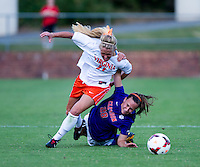 Brittany Ratcliffe (11) of Virginia is fouled by Emily Byorth (28) at Klockner Stadium in Charlottesville, VA.  Virginia defeated Clemson, 3-0.
