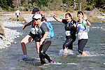 NELSON LAKES, NEW ZEALAND - APRIL 18:  XXXXX crosses the Travers River during the 2015 Alpine Lodge Loop The Lake trail run at Lake Rotoiti on April 18 16, 2015 in Nelson, New Zealand. (Photo by Marc Palmano/Shuttersport Limited)