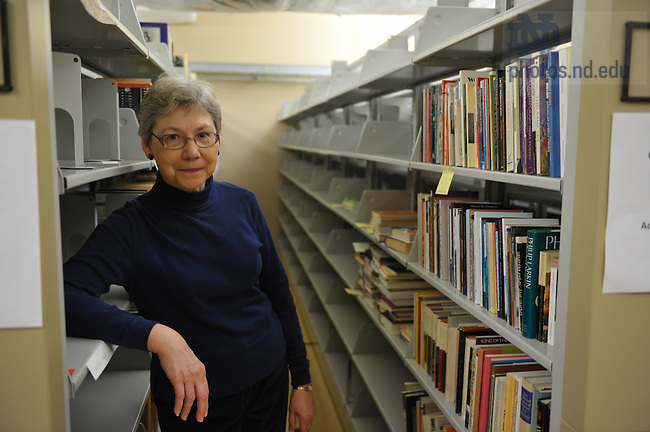 Librarian Laura Fuderer stands with the Sam Hazo poetry collection in its temporary home in the Special Collections stacks.  For Library Access Newsletter..Photo by Matt Cashore/University of Notre Dame