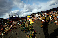 Members of Japan Self Defense Force continue search for tsunami victims through rubbles of Kesennuma town, Miyagi prefecture more than two weeks after the area was devastated by a magnitude 9.0 earthquake and tsunami March 27, 2011. The March 11 quake and tsunami have left at least 27,000 dead and missing in northeast Japan.    REUTERS/Damir Sagolj (JAPAN)