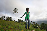 """Paula Prevost, a member of Nouvel Etwal - Haitian Kreyol for """"New Stars"""" - dances on a hillside in Mizak, Haiti. Nouvel Etwal is a dance and creative movement group of 16 girls from age 8 to 13, based in the southern village of Mizak. According to Valerie Mossman-Celestin, an organizer of the group, """"Nouvel Etwal seeks to empowers girls to be self-confident and creative. The girls learn flexibility, discipline and teamwork, lessons they also need for life. Nouvel Etwal promotes health, well-being and enhanced self-worth. The girls are encouraged to live into a brighter future where girls and women are valued,  educated, and have equal opportunity to achieve their potential."""""""