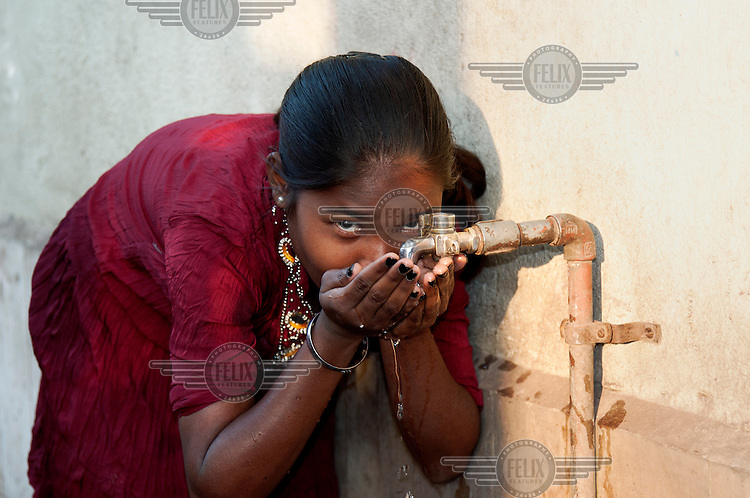 A girl is drinks water direct from a tap, Jamshedpur is one of the few places in India where this can be done without risk. Water here is supplied by Jusco, a Tata Steel administration, that maintains civic amenities and facilities in Jamshedpur