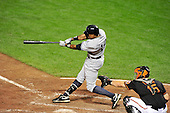 New York Yankees centerfielder Curtis Granderson (14) homers in the seventh inning against the Baltimore Orioles at Oriole Park at Camden Yards in Baltimore, Maryland in the second game of a doubleheader on Sunday, August 28, 2011.  The Yankees won the game 8 - 3, earning a split in the two games..Credit: Ron Sachs / CNP.(RESTRICTION: NO New York or New Jersey Newspapers or newspapers within a 75 mile radius of New York City)