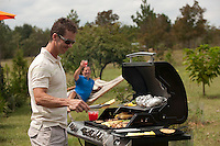 Two men having a barbecue and enjoying the day together