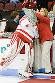 Kathi Brown, Adam Kraus (BU - 32), Rhonda Kraus - The Boston University Terriers honored their four seniors following their final game of the regular season on Saturday, March 5, 2011, at Agganis Arena in Boston, Massachusetts.
