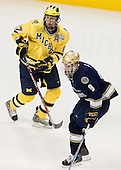 Mark Mitera (Michigan - 17), Ryan Thang (Notre Dame - 9) - The University of Notre Dame Fighting Irish defeated the University of Michigan Wolverines 5-4 in overtime in their 2008 Frozen Four Semi-Final matchup on Thursday, April 10, 2008, at the Pepsi Center in Denver.