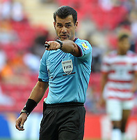 Referee's Carlos Vera during their FIFA U-20 World Cup Turkey 2013 Group Stage Group A soccer match France betwen USA at the Turk Telkom Arenain istanbul on June 24, 2013. Photo by Aykut AKICI/isiphotos.com