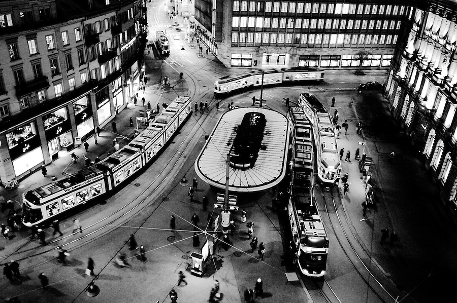 View of trams on Paradeplatz, centre of the Swiss banking industry, with the HQs of Switzerland's two largest banks, UBS at centre behind, and Credit Suisse at right. Bank vaults and their secrets are reputed to lie beneath the square.