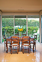 Dining area is seen during day with glass sliding doors