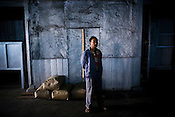 A factory worker at Makaibari Tea Estate factory, Kurseong in Darjeeling, India.