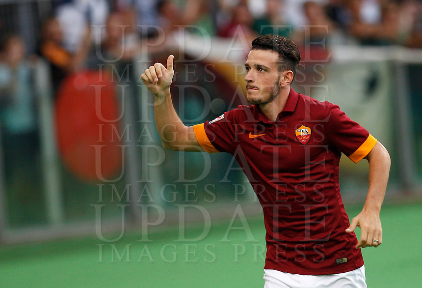 Calcio, amichevole Roma vs Fenerbahce. Roma, stadio Olimpico, 19 agosto 2014.<br /> Roma midfielder Alessandro Florenzi greets fans as he arrives for the team's presentation, prior to the friendly match between AS Roma and Fenerbahce at Rome's Olympic stadium, 19 August 2014.<br /> UPDATE IMAGES PRESS/Riccardo De Luca