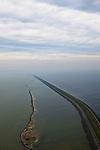 Nederland, Flevoland, IJsselmeer, 22-05-20011; Houtribdijk verbindt Enkhuizen en Lelystad en deelt het IJsselmeer in IJsselmeer en Markermeer (links). De foto is gemaakt richting Enkhuizen. De Houtribdijk is oorspronkelijk aangelegd om het Markeermeer in te polderen tot Markerwaard. De plannen voor deze inpoldering maakte reeds deel uit van de Zuiderzeewerken. Andere namen voor de dijk zijn: Markerwaarddijk, Lelydijk, Dijk Enkhuizen-Lelystad, N302..Houtrib dike linking Enkhuizen and Lelystad, dividing lake IJsselmeer in IJsselmeer and Marker lake(left). The photo was taken towards Enkhuizen. .The dike was originally built make the reclamation of the polder Markerwaard possible. The plans for the reclamation was already part of the Zuiderzee Works (1891)..luchtfoto (toeslag), aerial photo (additional fee required).foto/photo Siebe Swart