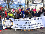 Duke Chapter of the NAACP at the Moral March<br /> My name: Celeste Hodges<br /> Duke connection: Current employee, a web developer in the Department of<br /> Computer Science<br /> Email: hodges@cs.duke.edu<br /> <br /> The photo: Students in the Duke Chapter of the NAACP participate in the<br /> Moral March in Raleigh NC on February 14.
