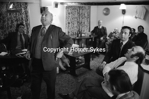 Stowell Court and Candle Auction, Tatworth, Somerset, England 1975. Auction takes place in lounge bar of the Poppe Inn.<br />