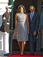 United States President Barack Obama and first lady Michelle Obama depart the Diplomatic Entrance as they host an Official Arrival ceremony in honor of Prime Minister Matteo Renzi and Mrs. Agnese Landini of Italy on the South Lawn of the the White House in Washington, DC on Tuesday, October 18, 2016. <br /> Credit: Ron Sachs / CNP /MediaPunch