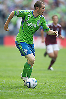 Seattle Sounders FC forward Nate Jaqua dribbles the ball during play against the Colorado Rapids at CenturyLink Field in Seattle Saturday July 17, 2011. The Sounders won the game 4-3.
