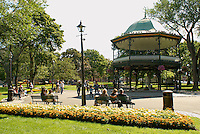People relaxing in King's Square in the city of Saint John, New Brunswick, Canada