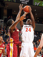 Dec. 30, 2010; Charlottesville, VA, USA; Virginia Cavaliers guard K.T. Harrell (24) shoots over Iowa State Cyclones guard Darion 'Jake' Anderson (5) during the game at the John Paul Jones Arena. Iowa State Cyclones won 60-47. Mandatory Credit: Andrew Shurtleff