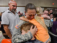 Daily Photo by Gary Cosby Jr.  ..Ashleigh Holt cries as she hugs her brother Tyler and sister Skylar during the deployment ceremony for the 152nd Military Police company of the Alabama Army National Guard unit based in Hartselle Sunday, June 24, 2012 at the Sparkman Civic Center.  Their father, Travis Holt, is at left.