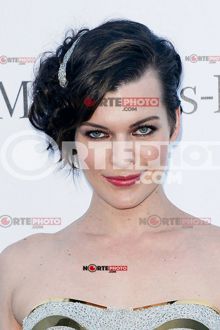 Milla Jovovich (wore a Versace dress) attends the amfAR Gala at Hotel du Cap-Eden-Roc in Cannes, 24th May 2012...Credit: Timm/face to face /MediaPunch Inc. ***FOR USA ONLY***