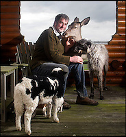 BNPS.co.uk (01202 558833)<br /> Pic: DavidFitzgerald/BNPS<br /> <br /> Kenny with roe deer Yanna and his Irish wolfhound-deerhound cross Murphy, accompanied by a long-horned calf.<br /> <br /> Supplying farm animals to TV and film crews, including the huge hit series Game of Thrones, has saved Kenny Gracey's bacon.<br /> <br /> The 57-year-old farmer started supplying pigs, cows, donkeys, goats and even a trained deer to Hollywood seven years ago, when the recession was hitting his business hard.<br /> <br /> Mr Gracey said the film work his animals get has helped him pay the bills and keep his business going.<br /> <br /> Forthill Farm in Tandragee, Northern Ireland, specialises in traditional breeds like Longhorn cattle and Gloucestershire old spot pigs, ideal for shows and films set in medieval times.