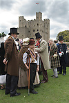 Charles Dickens Festival. Rochester Kent UK. Characters from the play A Christmas Carol. Showing Tiny Tim. Rochester castle background. 2012.