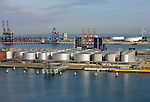 Storage tanks and wind turbines are seen at the port of Rotterdam in The Netherlands, on Tuesday, Oct. 27, 2009. The Port of Rotterdam's throughput fell 12 percent in the first nine months and is expected to decline between 10 and 11 percent this year, according to port director Hans Smits. (Photo © Jock Fistick)