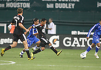 Andy Najar #14 of D.C. United passes away from Josue Flores #20 of El Salvador during an international charity match at RFK Stadium, on June 19 2010 in Washington DC. D.C. United won 1-0.