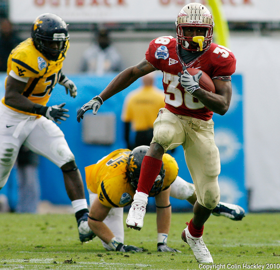 JACKSONVILLE, FL 1/1/10-FSU-WV FB CH36-Florida State's Jermaine Thomas leaves West Virginia defenders in the dust during first half Gator Bowl action Friday in Jacksonville, Fla. .COLIN HACKLEY PHOTO