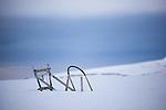 Dogsled in the snow, beside Mushamna hunters cabin, in Woodfjorden, Svalbard