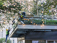 Workers waste no time removing the signage from the popular Shake Shack restaurant in Madison Square Park in New York on Tuesday, October 14, 2014. The popular eatery closed its doors at the end of business Monday until mid-2015 while the building undergoes a major renovation. Burger lovers will have to content themselves with one of the almost 36 other locations of the chain. (© Richard B. Levine)