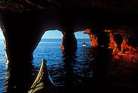 Sea kayakers explore the sea caves on Devils Island in the Apostle Islands National Lakeshore near Bayfield, Wis.
