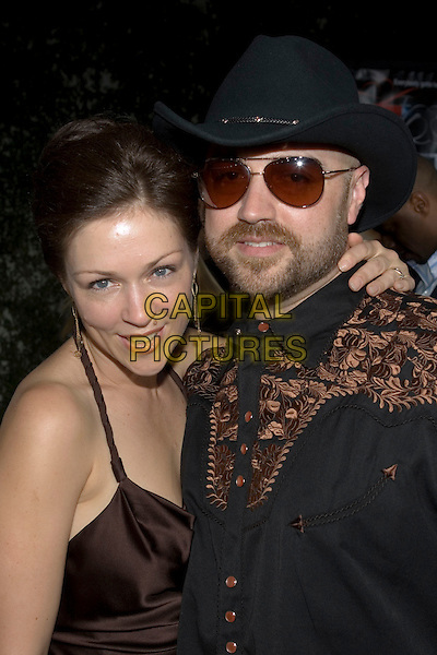 """CRAIG BREWER & GUEST.At the """"Hustle & Flow"""" Los Angeles Film Premiere,.held at the Arclight Cinerama Dome, .Hollywood, California, USA, 20th July 2005..portrait headshot sunglasses beard hat cap.Ref: ADM.www.capitalpictures.com.sales@capitalpictures.com.©Zach Lipp/AdMedia/Capital Pictures."""