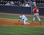 Ole Miss' Matt Smith (16) digs the throw out of the dirt to force out Georgia's Kevin Ruiz (36) in college baseball action at Oxford-University Stadium in Oxford, Miss. on Friday, April 8, 2011. Georgia won 9-8.