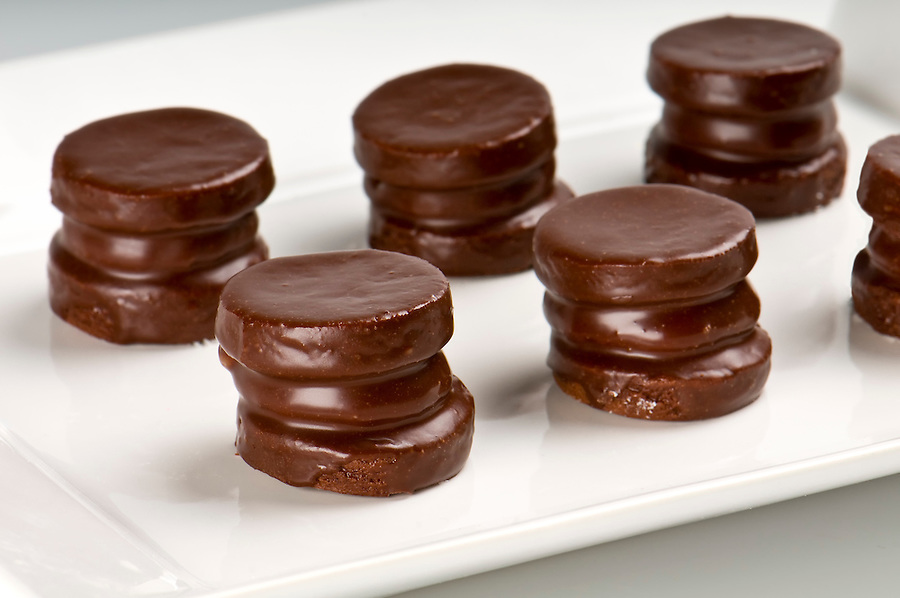 Group of chocolate cookies, also a traditional argentiean sweet, called alfajor covered with chocolate.
