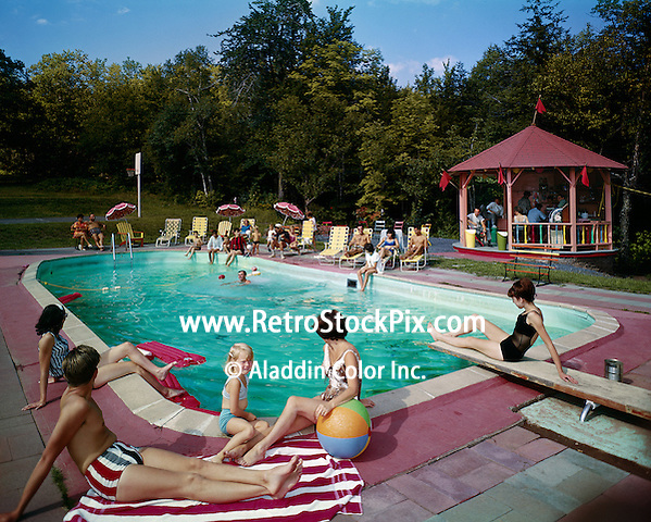 A young family sitting by pool with the colorful gazebo in the background.