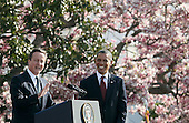 British Prime Minister David Cameron (L) speaks while U.S. President Barack Obama listens during an official arrival ceremony at the South Lawn of the White House March 14, 2012 in Washington, DC. Prime Minister Cameron is on a three-day visit in the U.S. and he is expected to have talks with President Obama on the situations in Afghanistan, Syria and Iran. .Credit: Mark Wilson - Pool via CNP