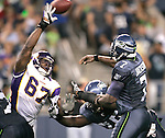 Minnesota Vikings'  defensive end Adrian Awasom pass rushes Seattle Seahawks quarterback Tavaris Jackson in the quarter of a pre season game on Saturday August, 2011 at CenturyLink Field in Seattle.   The Vikings beat the Seahawks  20-7. ©2011 Jim Bryant Photo. All Rights Reserved.