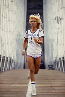 June 1979. Manhattan, NY. Portrait of Sylvie Vartan running on the Brooklyn Bridge.