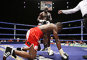 Osumanu Akaba (Ghana, black shorts) defeats Tshifhiwa Munyai (Johannesburg, red shorts) in a Bantamweight contest at Goresbrook Leisure Centre, Dagenham, Essex promoted by Frank Maloney / FTM Sports - 18/07/08 - MANDATORY CREDIT: Gavin Ellis/TGSPHOTO - Self billing applies where appropriate - Tel: 0845 094 6026.