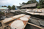 Freshly made rice noodle sheets dry outside at a small factory in the Mekong Delta, south of Can Tho, Vietnam. Sept. 30, 2011.