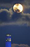 May's full moon rose over Telegraph Hill as seen Aquatic Park Pier, SF., CA.